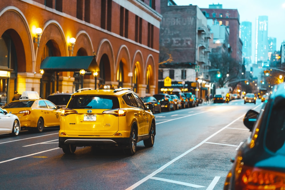 yellow taxi cab on a street