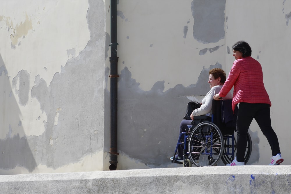 woman sitting on gray wheelchair