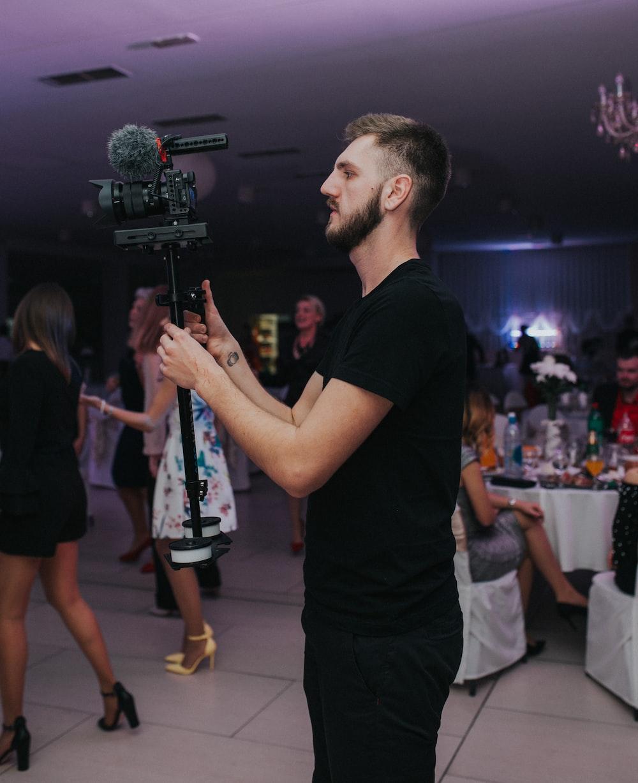 man recording women dancing