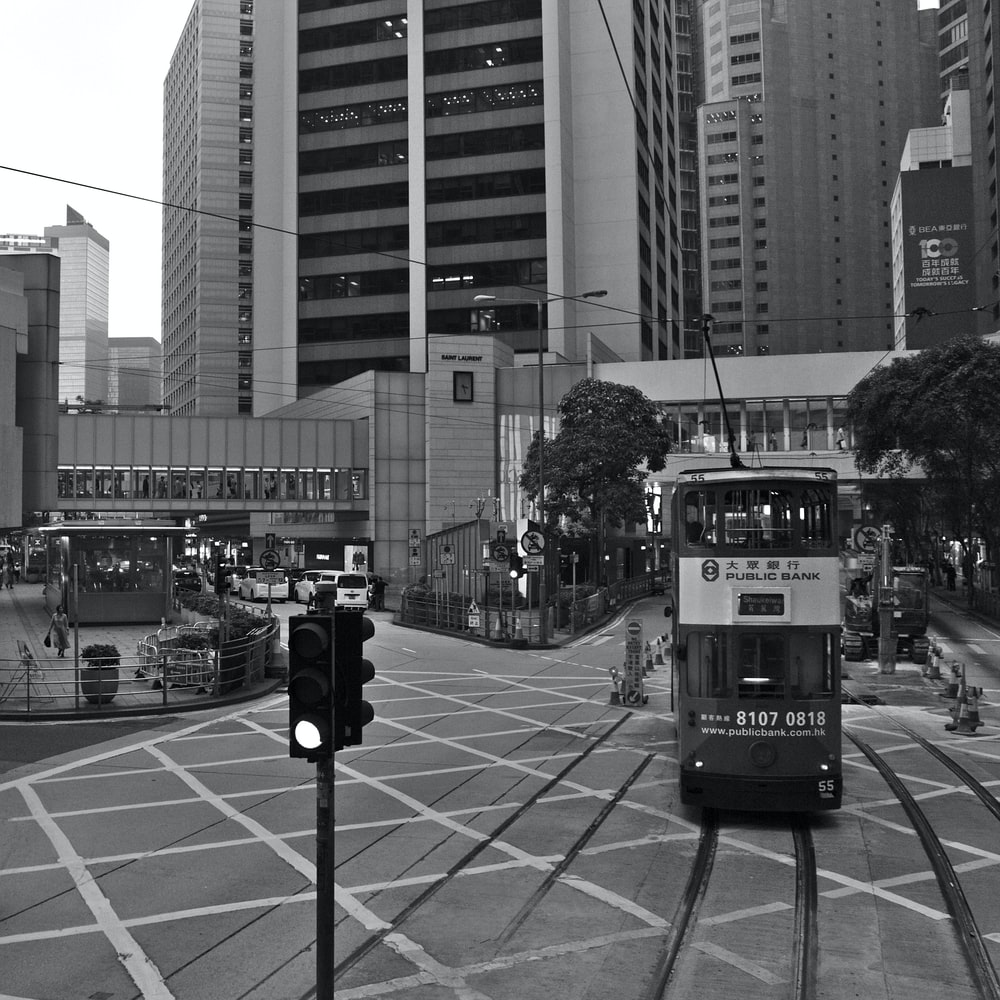 grey scale photography of train near building