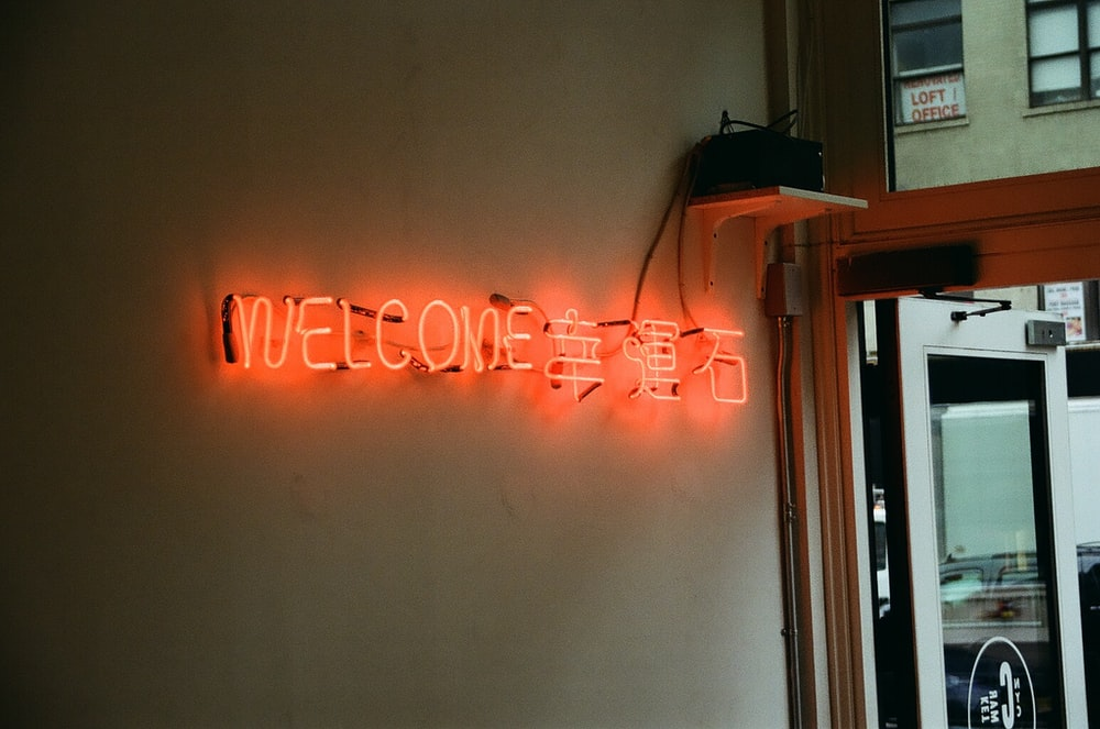 welcome lighted neon sigange