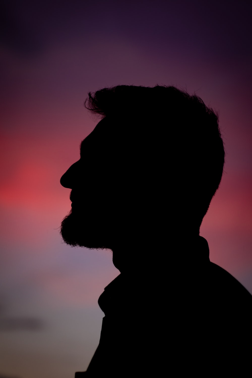 silhouette of man during dusk