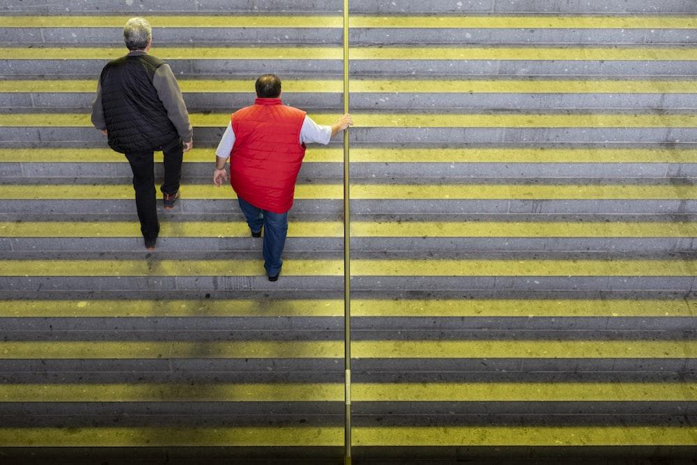 people walking on staircase during daytime