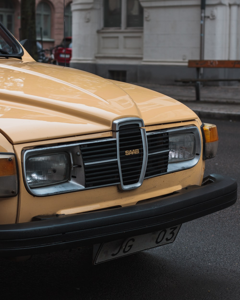 yellow Saab car
