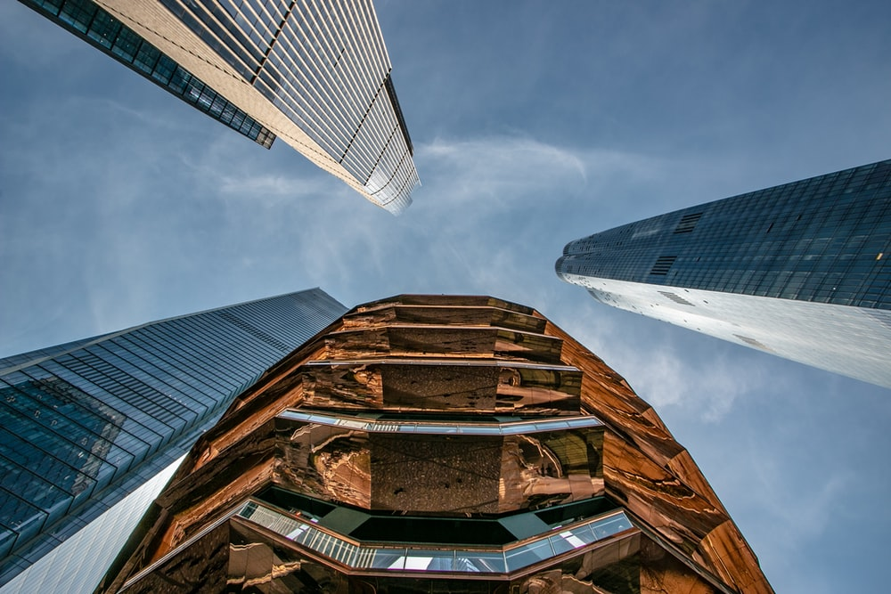 low angle photo of four high rise buildings