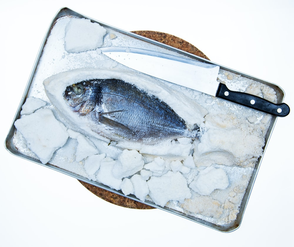 fish next to kitchen knife