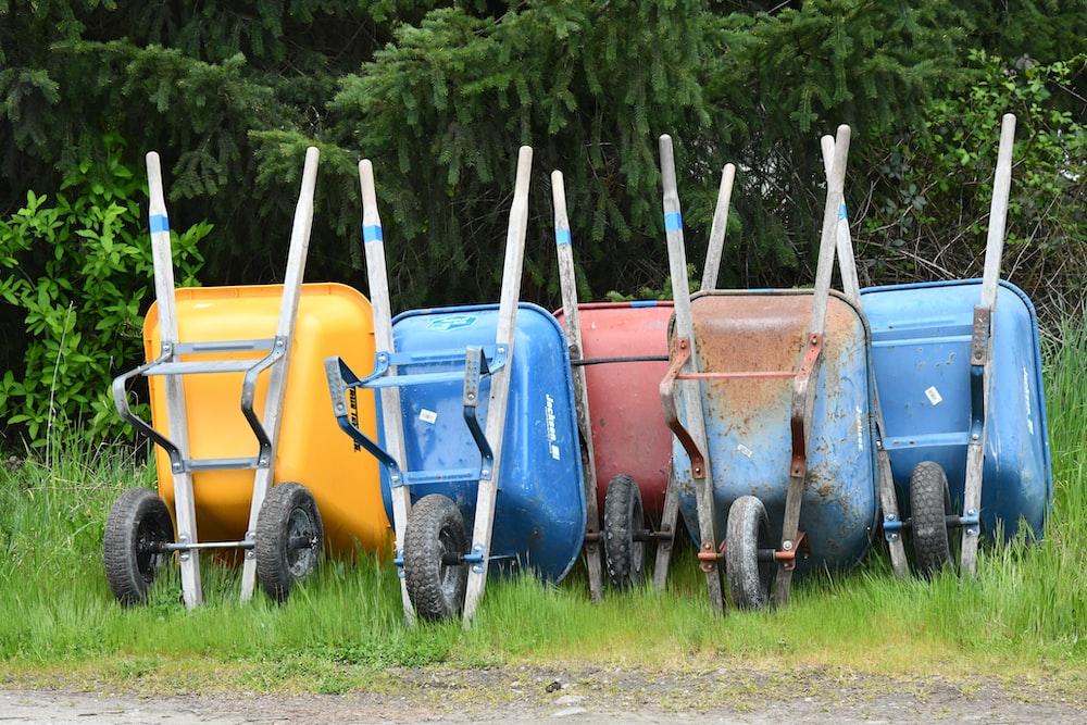 assorted-color wheelbarrows