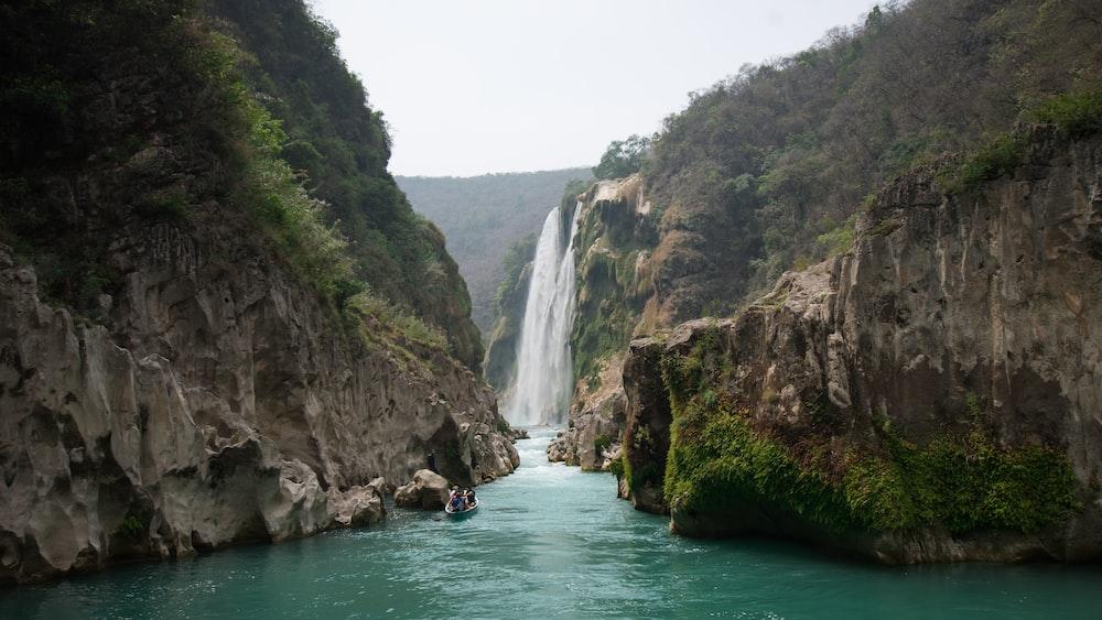 waterfalls on green mountain