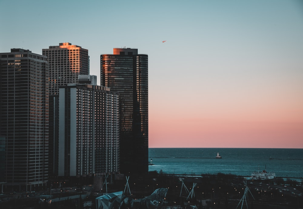 high rise buildings in beach at sunset