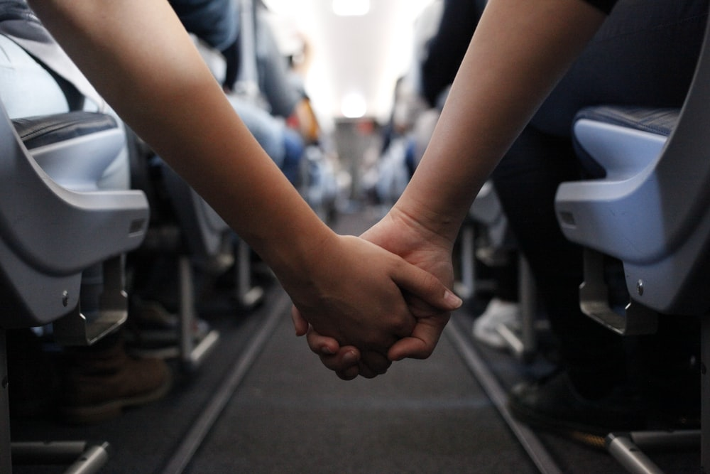 two hand holding close-up photography