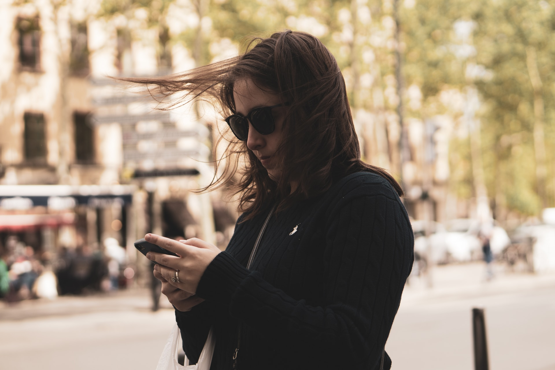 woman standing and using phone hone
