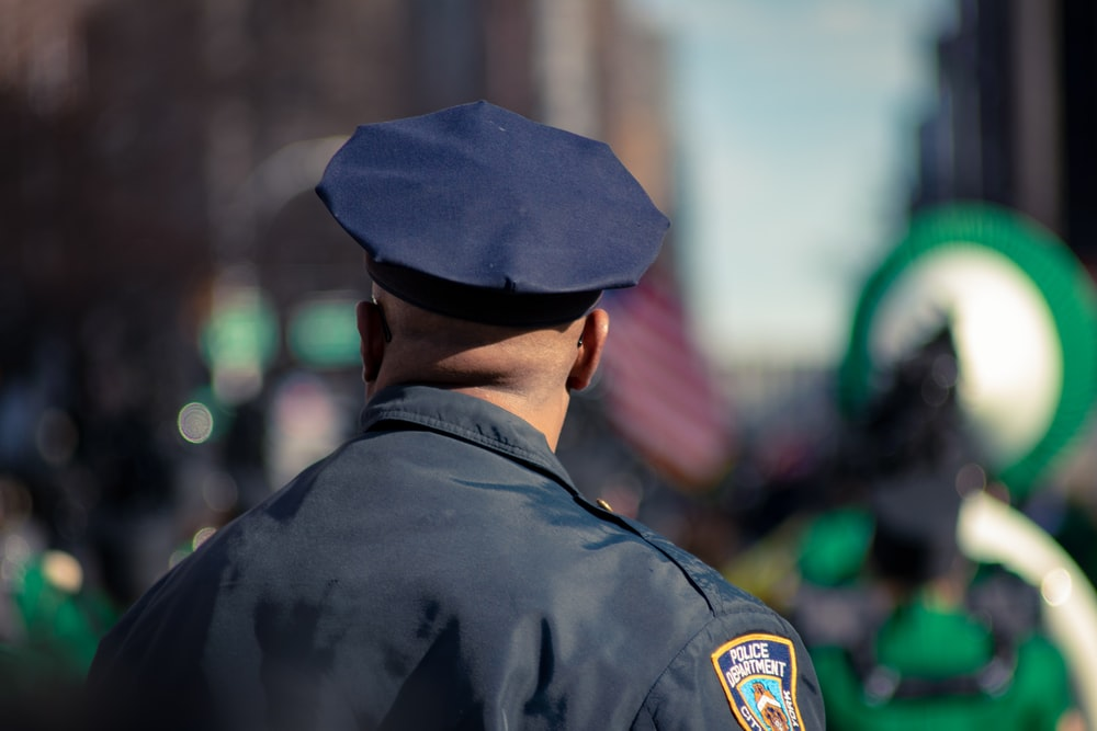 man wearing police uniform selective focus photo
