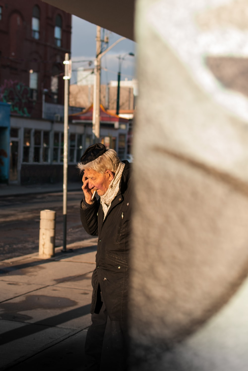 man calling on phone near the street