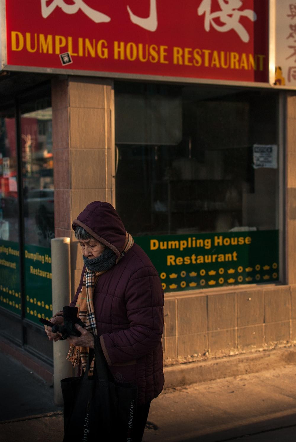 woman passing through dumpling restaurant