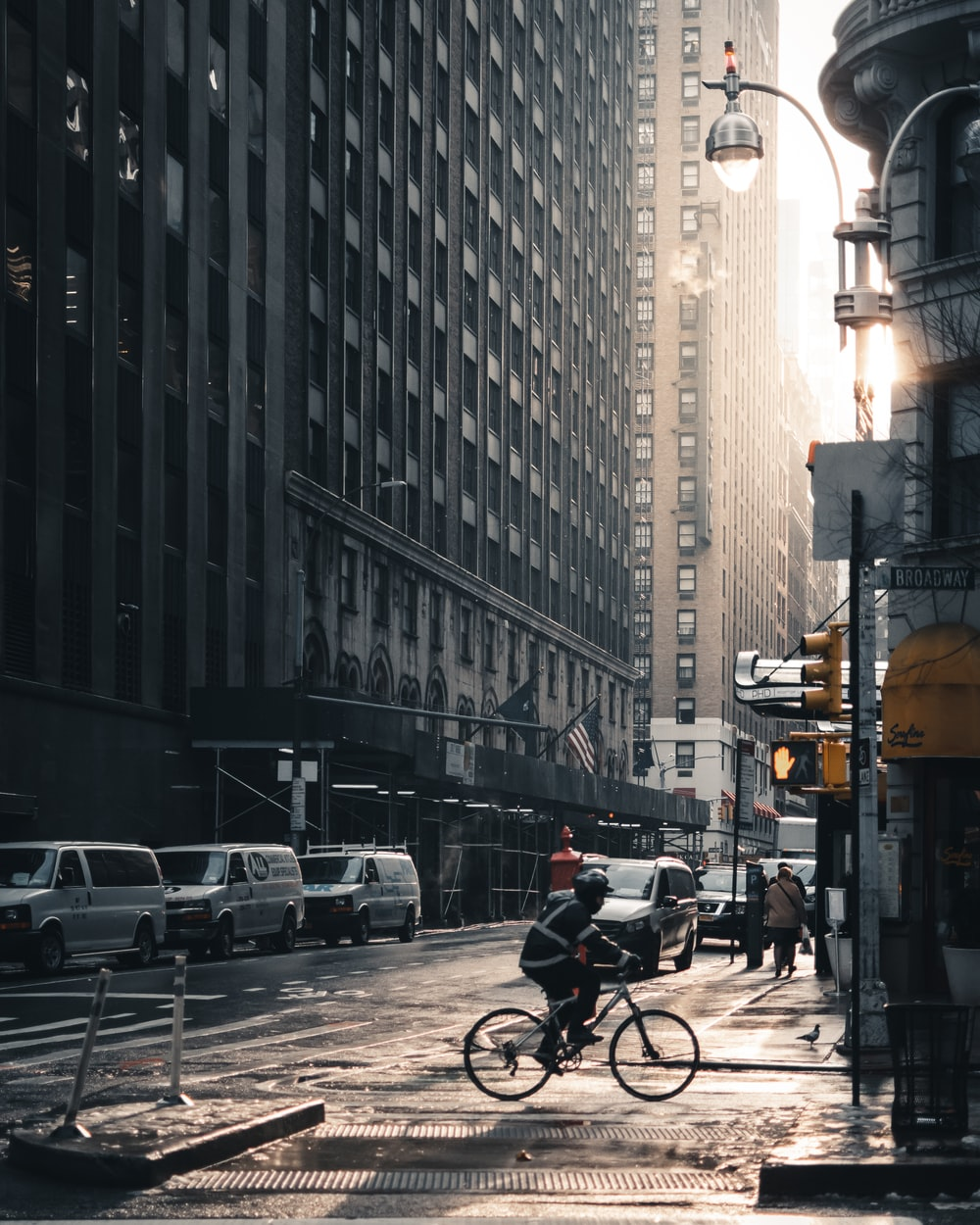 man on bicycle near building