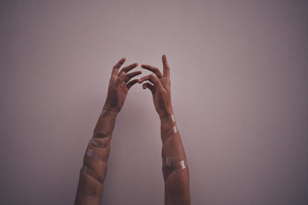 person hands with gray wraps