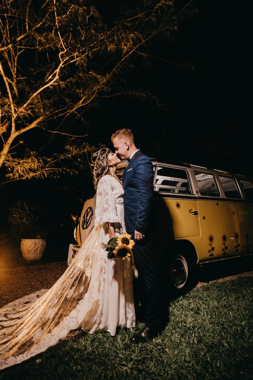 couple kissing near the van