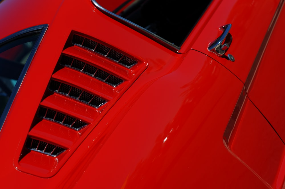 closeup photo of red vehicle