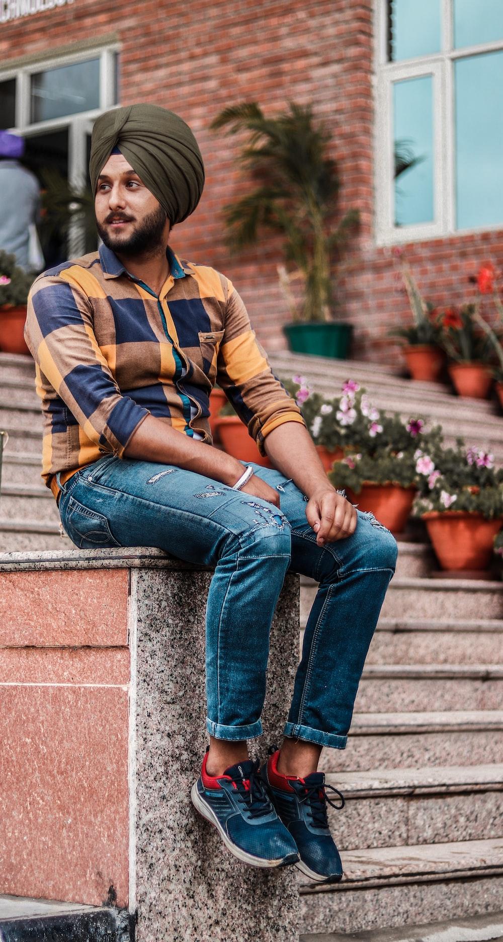 man wearing blue denim jeans