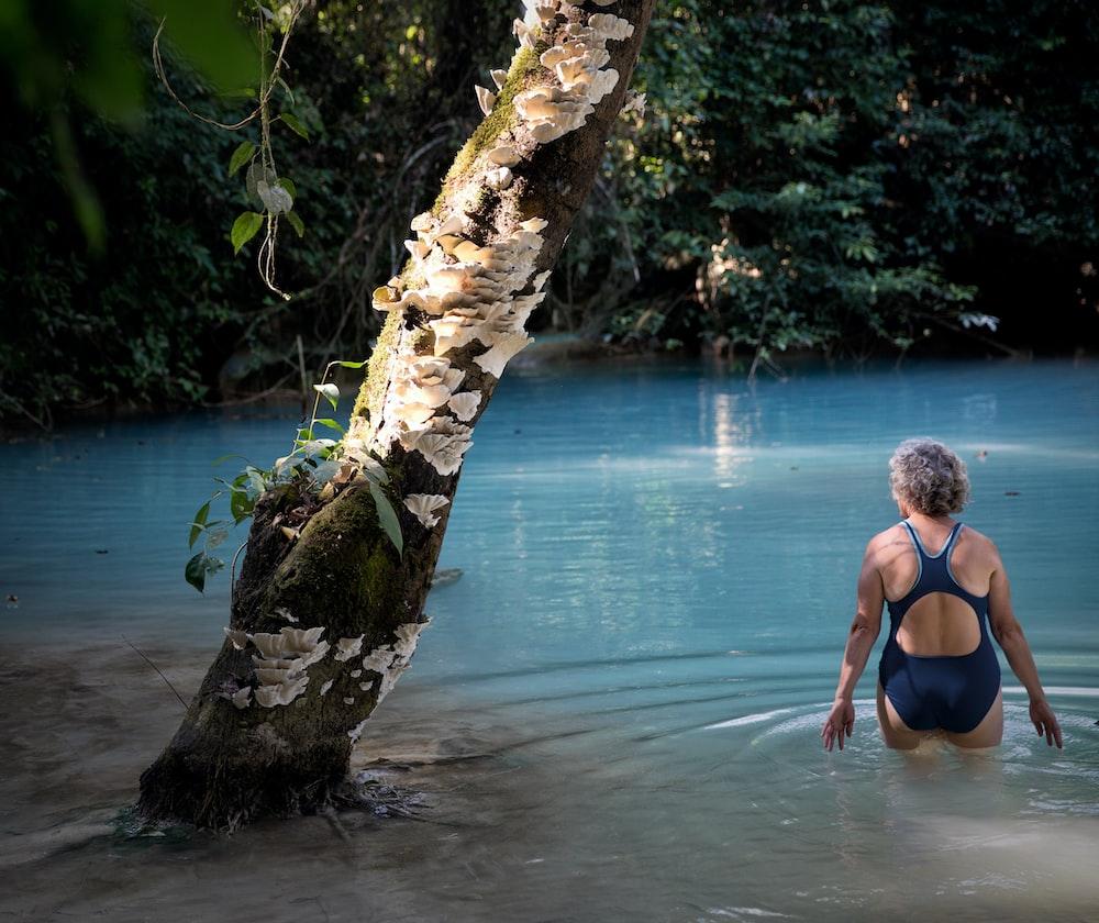 woman wearing bikini near tree