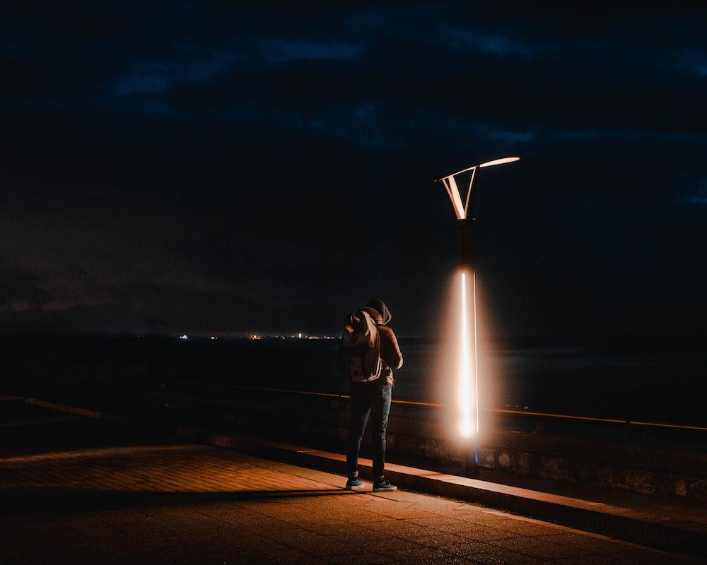 person standing beside light