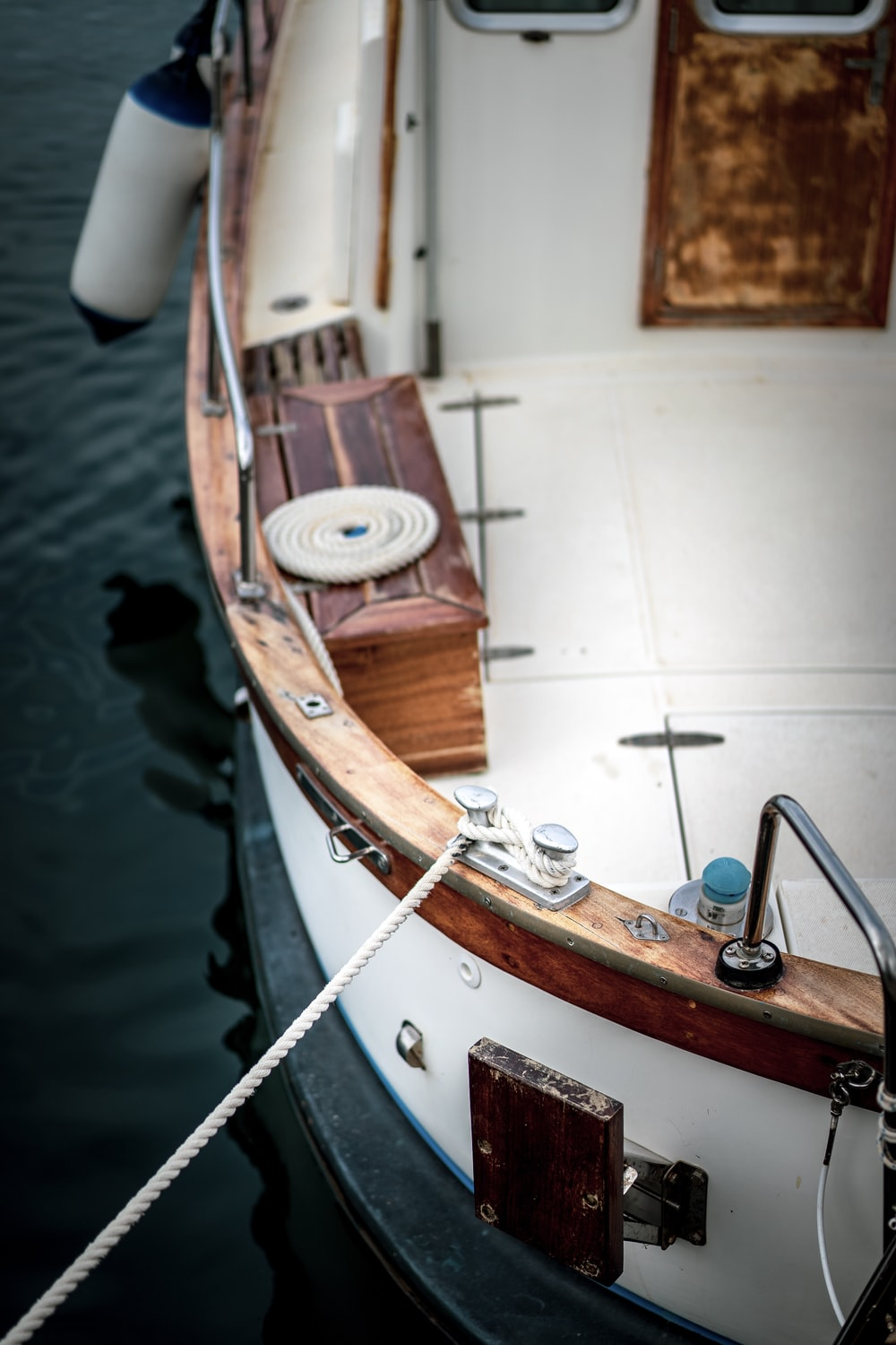 white and brown boat
