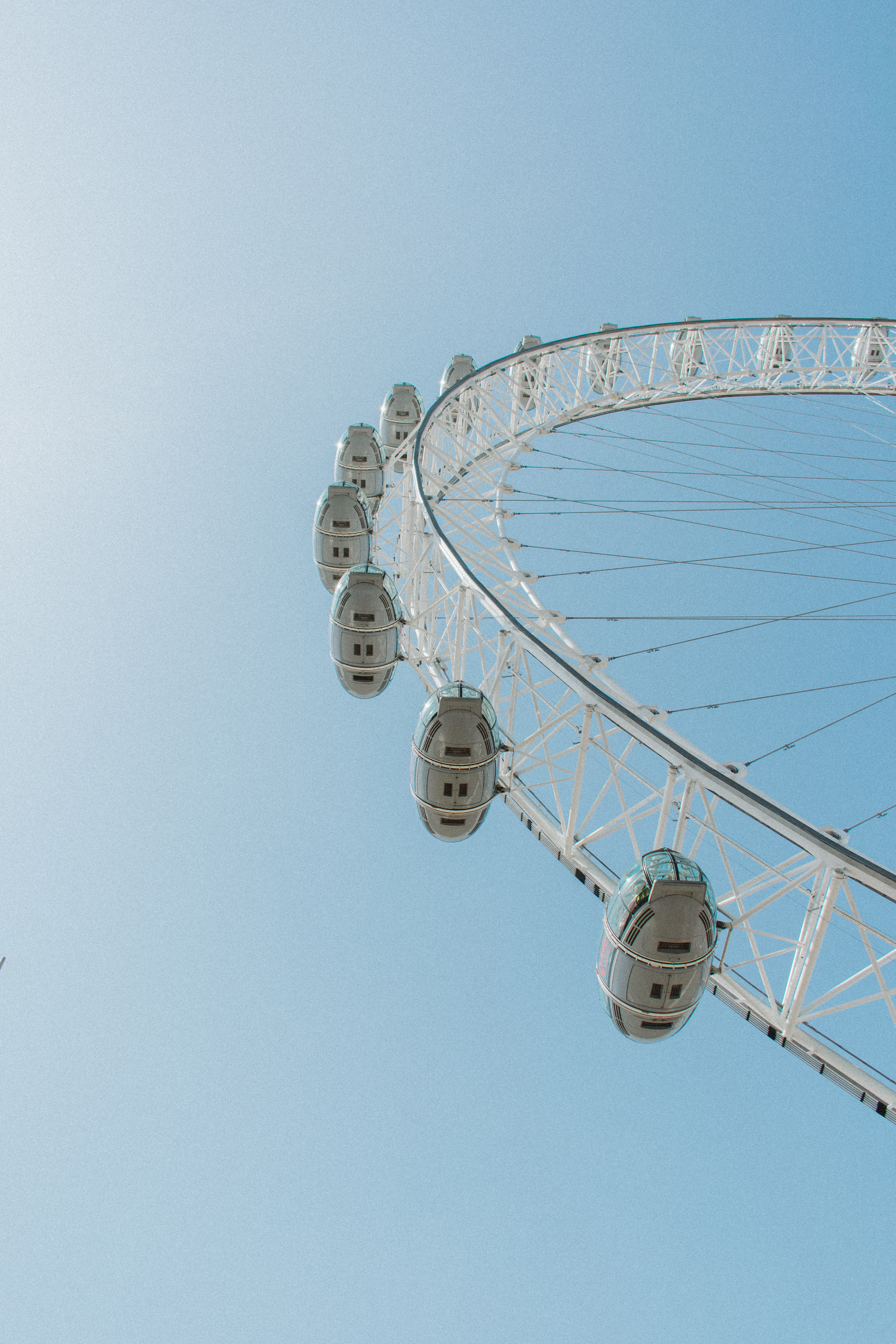 low-angle photography of white ferris-wheel