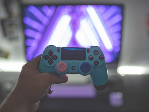 A person holds a video game controller.