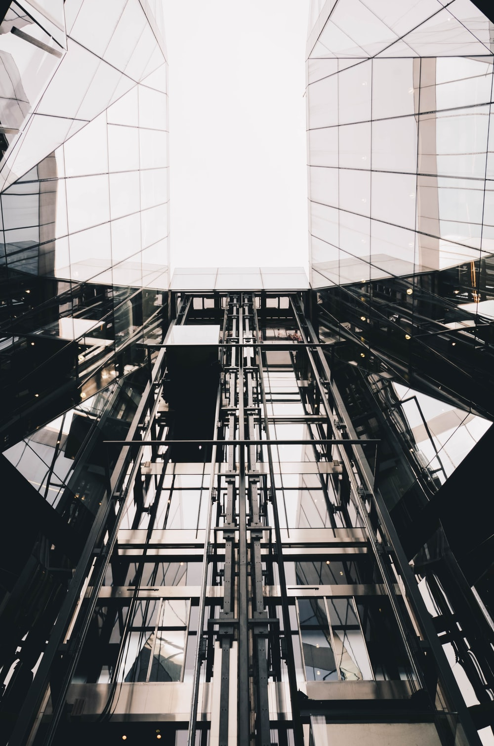 low angle photography of building's elevator system