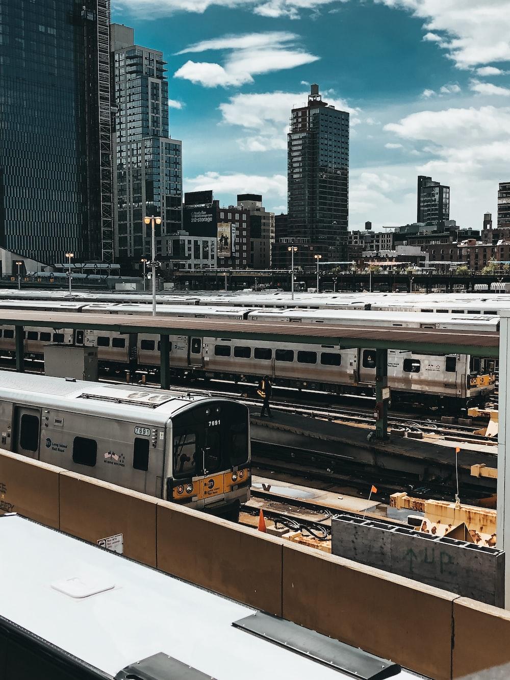 gray and black train on railway