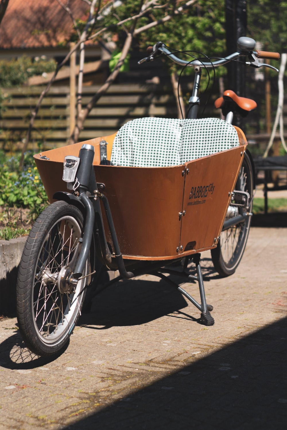 brown bicycle with trailer