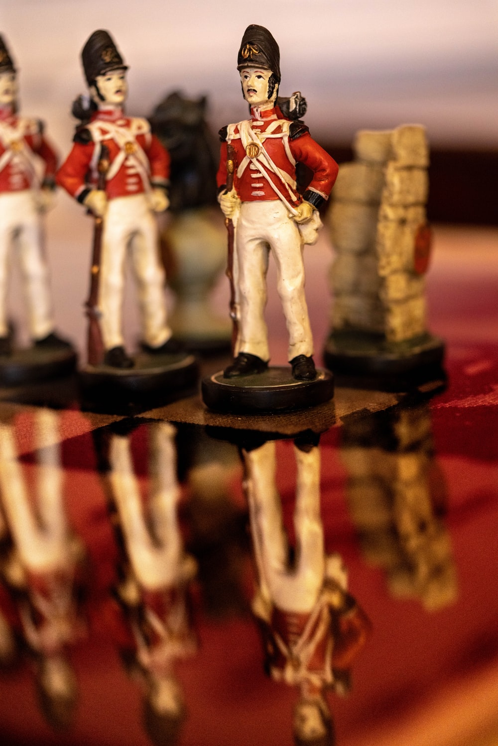 red and white soldier ceramic figurines