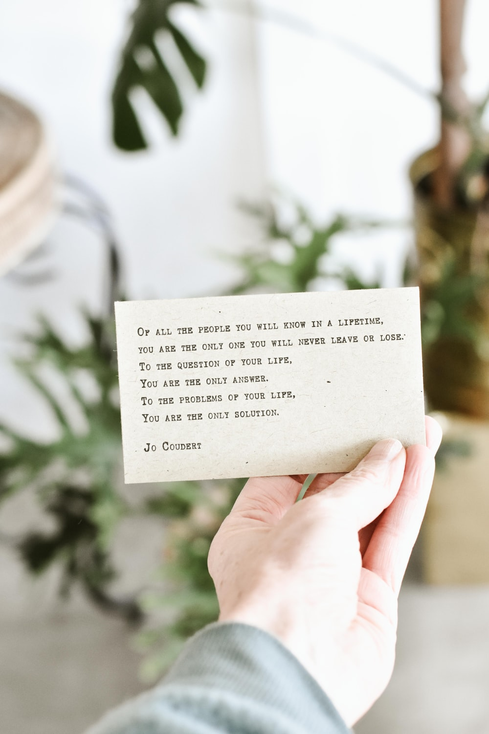 person holding quote card