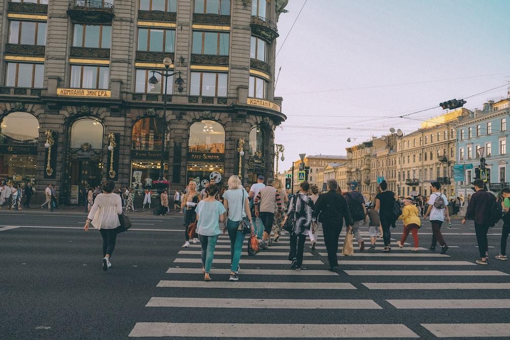 people crossing in pedestrian lane