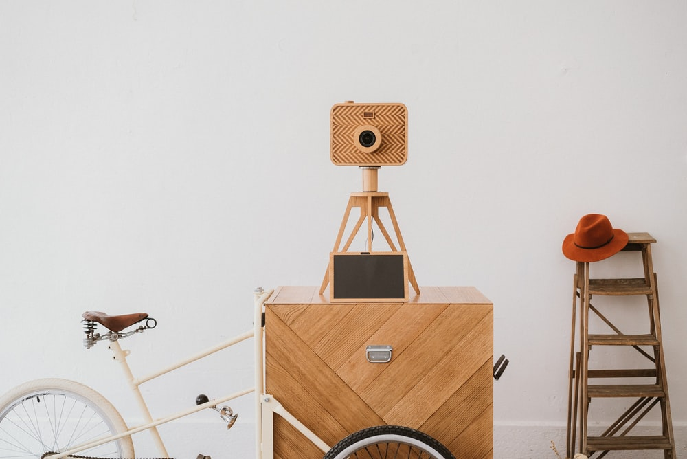 camera on tripod beside bicycle