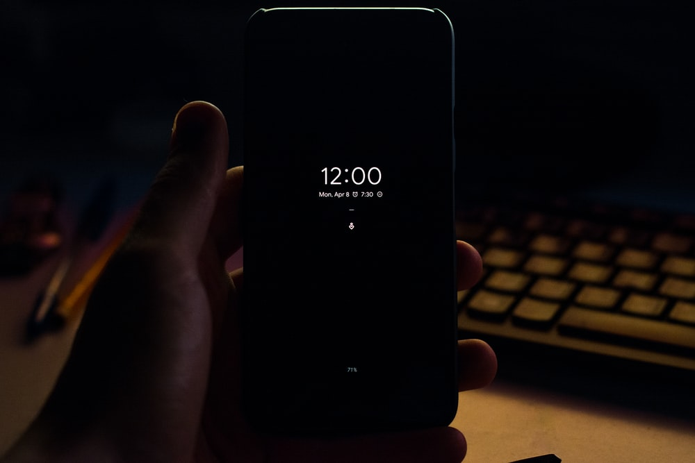 smartphone displaying 12:00 time