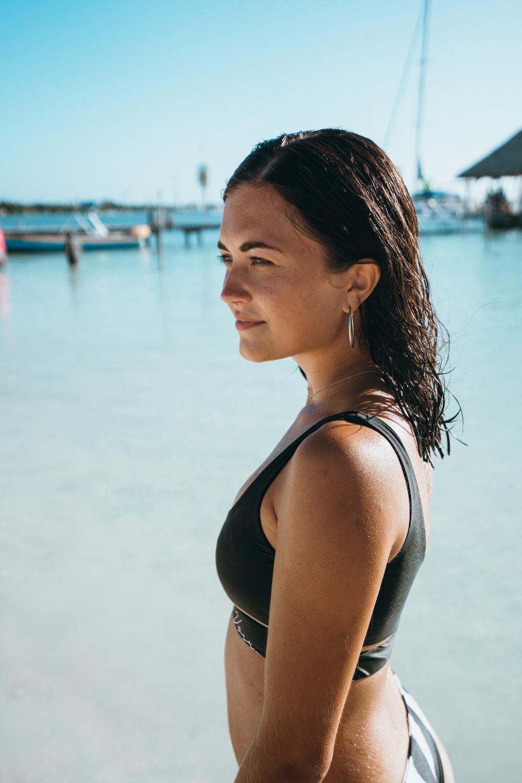 woman wearing bikini bra near dock