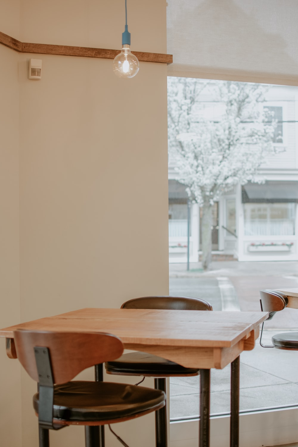 brown wooden table and chairs in room