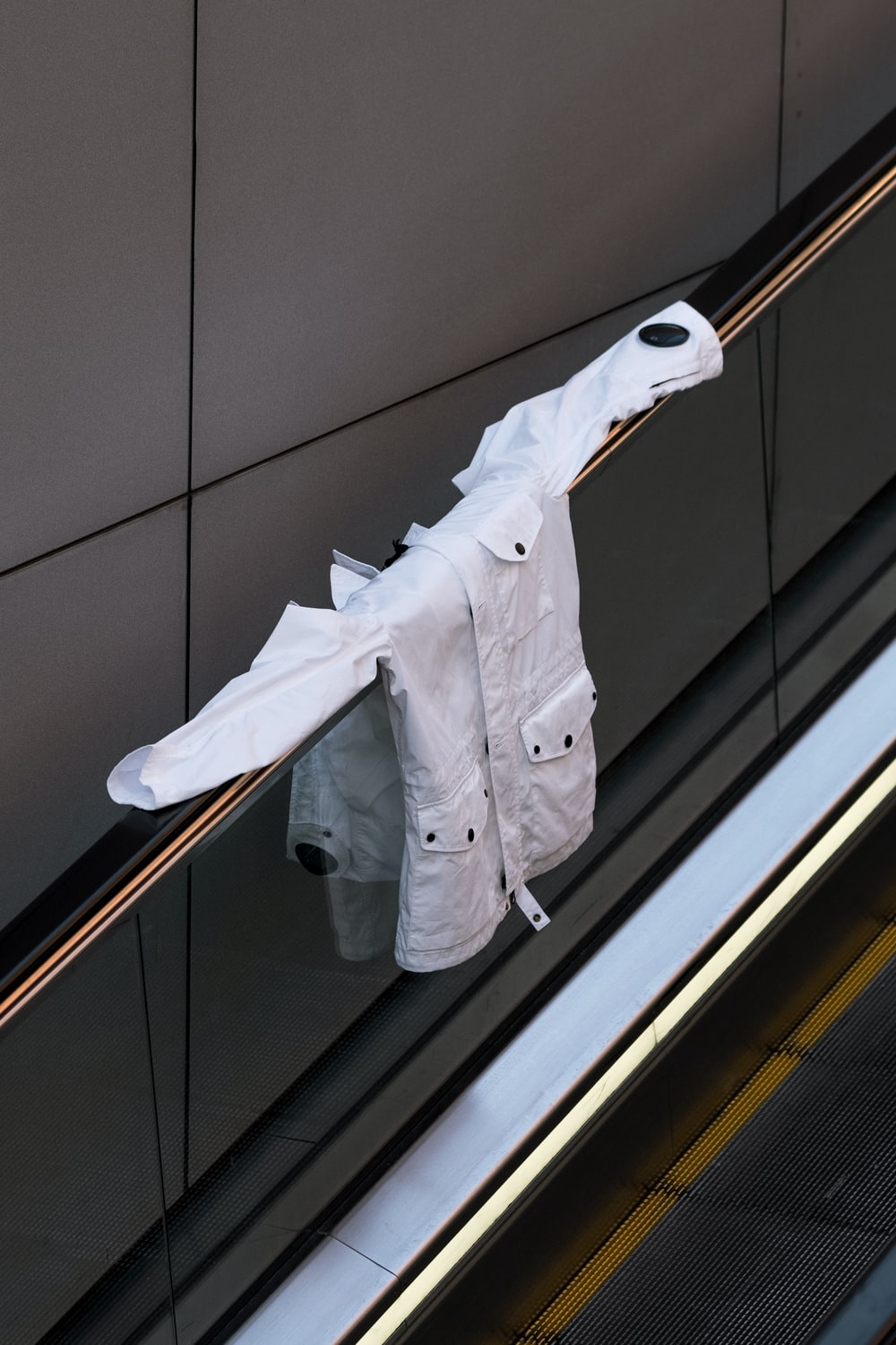 white dress in an escalator close-up photography