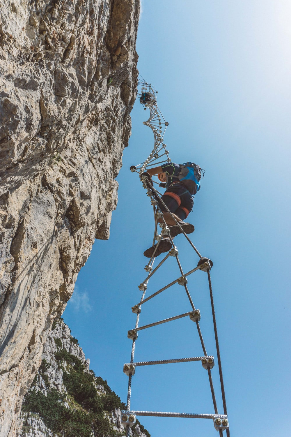 person climbing rope ladder