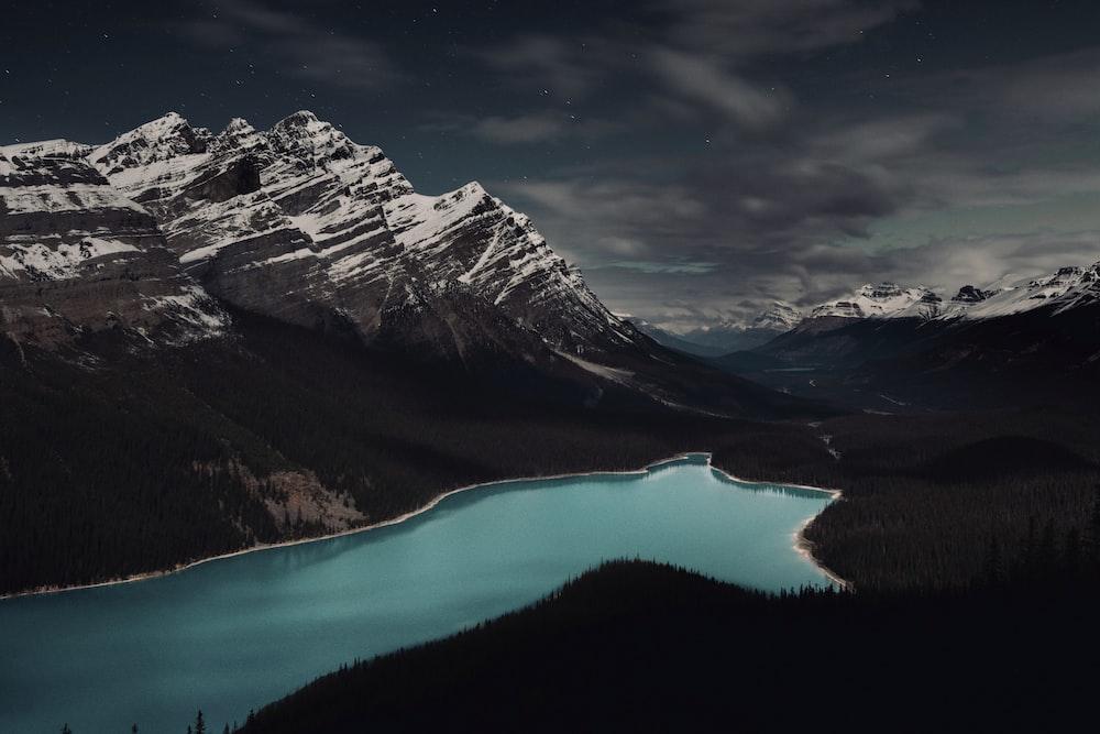 mountain alps surrounding body of water