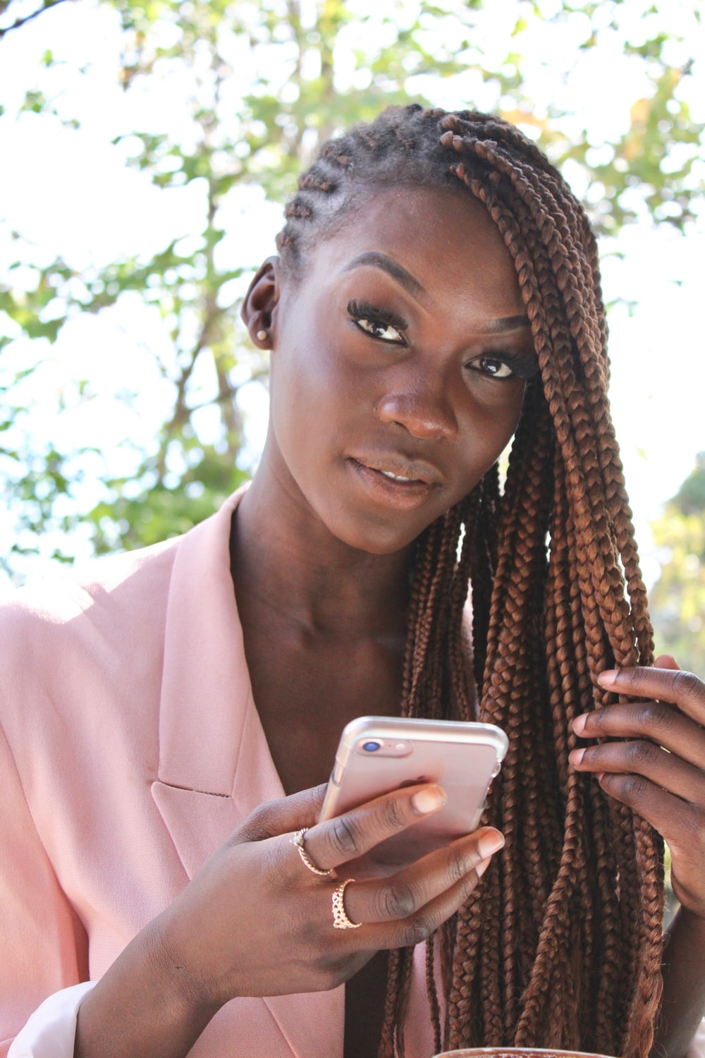woman holding rose gold iPhone 7