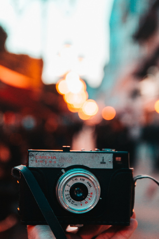 focus photography of black camera