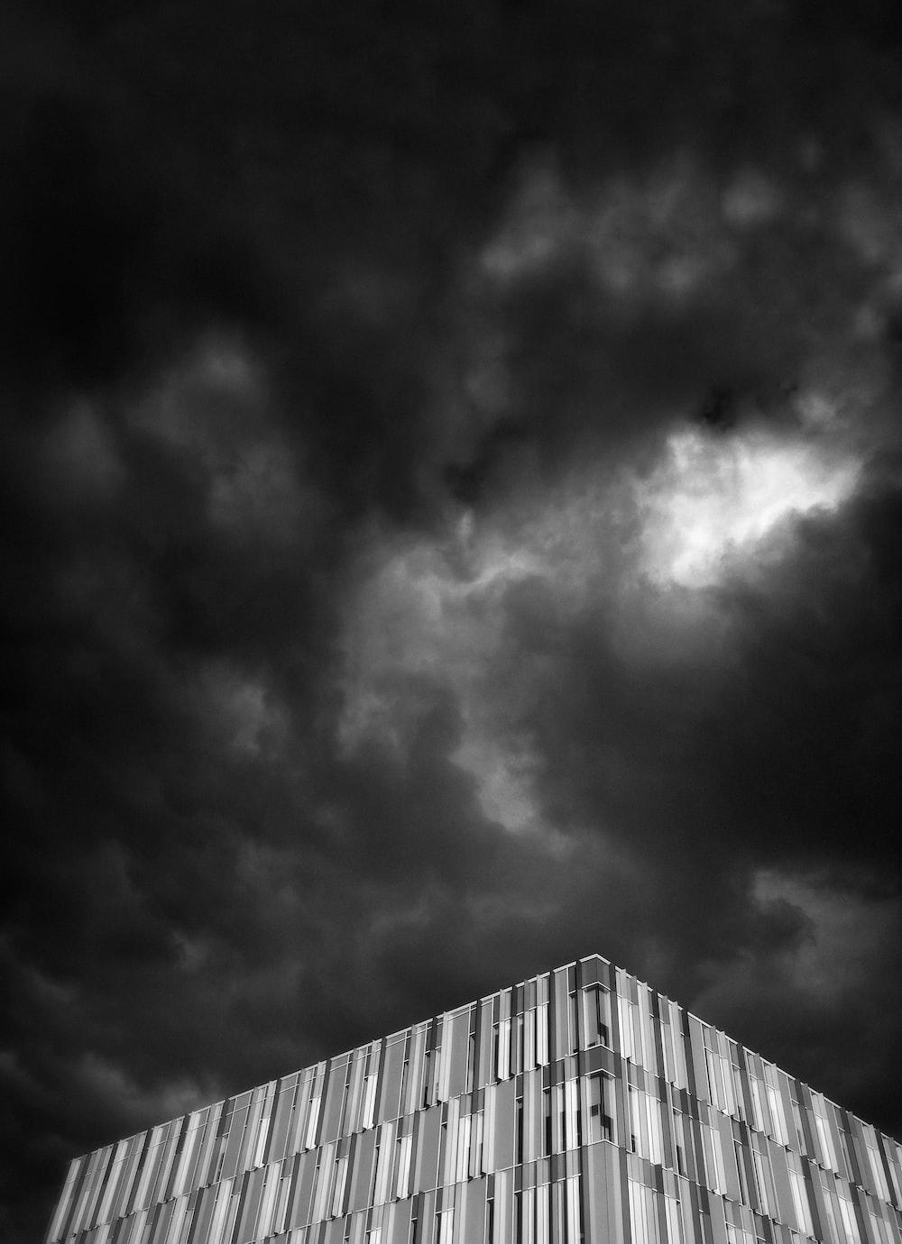 building under black cloud