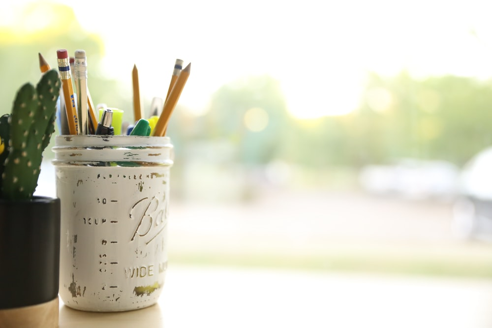 yellow pencil on white mason jar