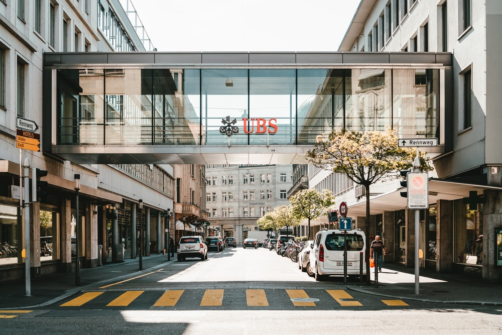UBS logo on glass bridge wall during daytime
