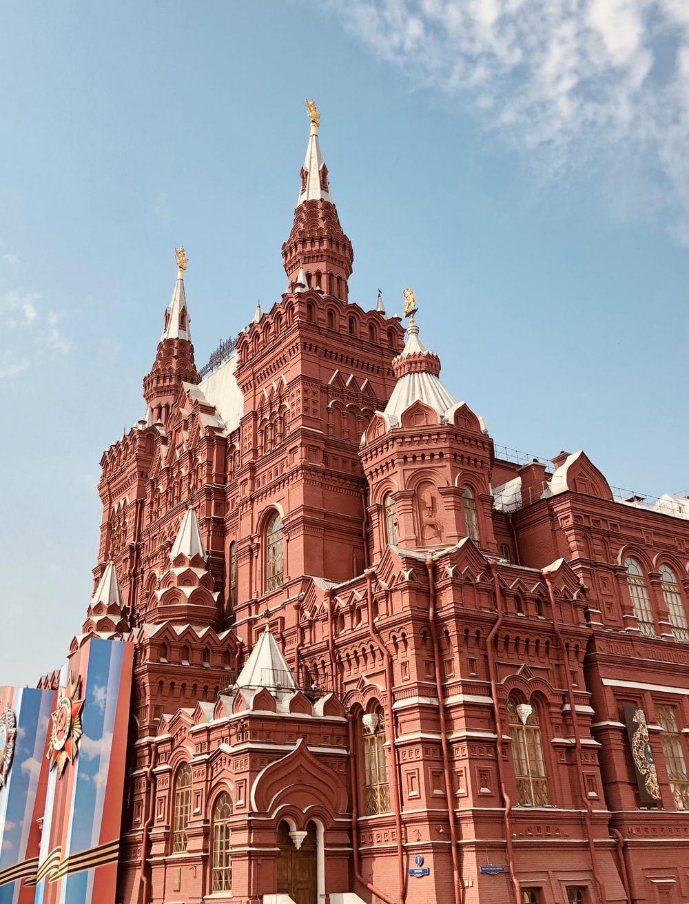 low-angle photography of red cathedral
