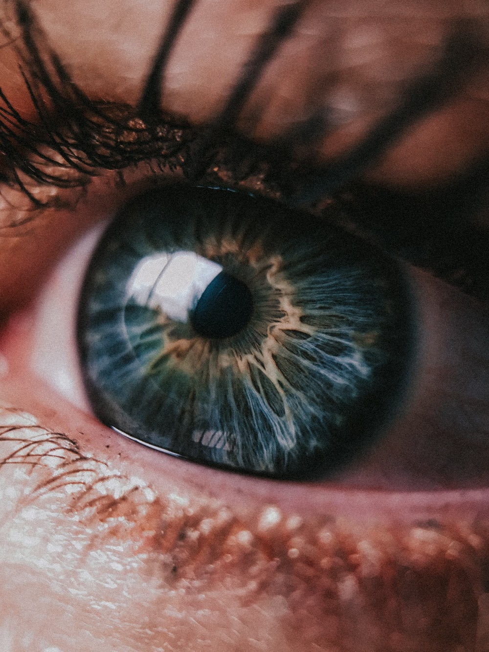 person showing left green eye