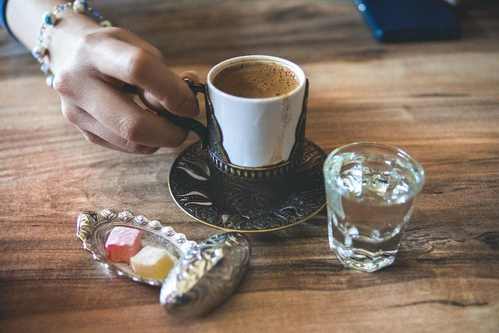 white ceramic cup near mug
