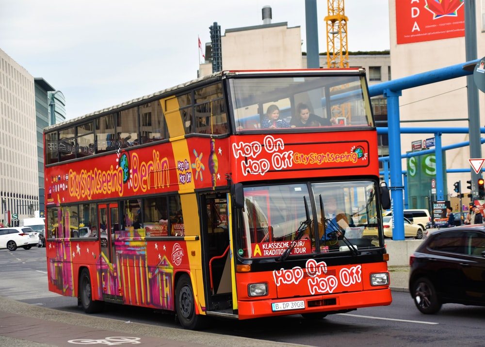 red double deck bus during daytime